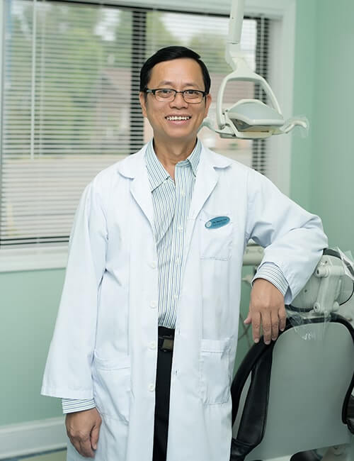 Headshot of our friendly Dentist Doctor Tan Binh Nguyen