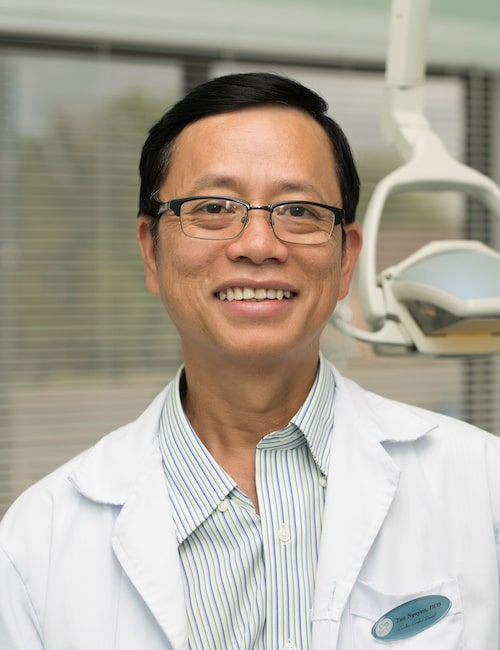 Dr. Tan Binh Nguyen smiling and wearing glasses