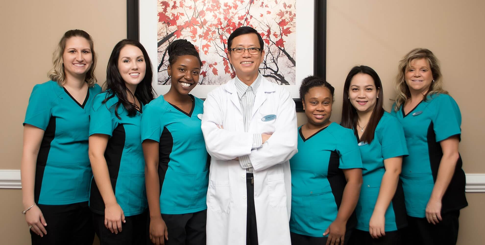 Dr. Dr. Tan Binh Nguyen and his dental team n Fayetteville, NC